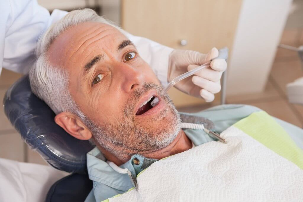 who offers dental implants north miami?