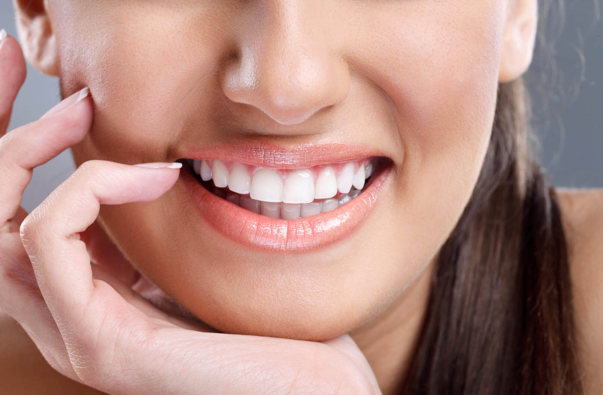Closeup of a woman smiling at an Before and after photos of teeth whitening at Aventura Dentist