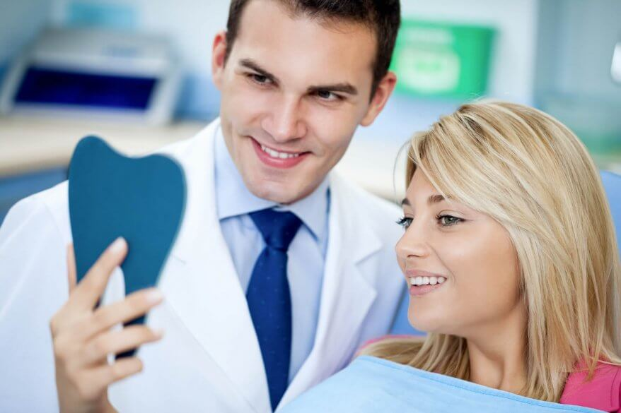 Dentist and patient in the office for a Teeth Whitening in North Miami